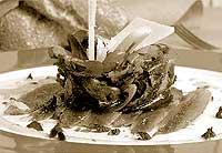 Ensalada de anchoas marinadas tibias